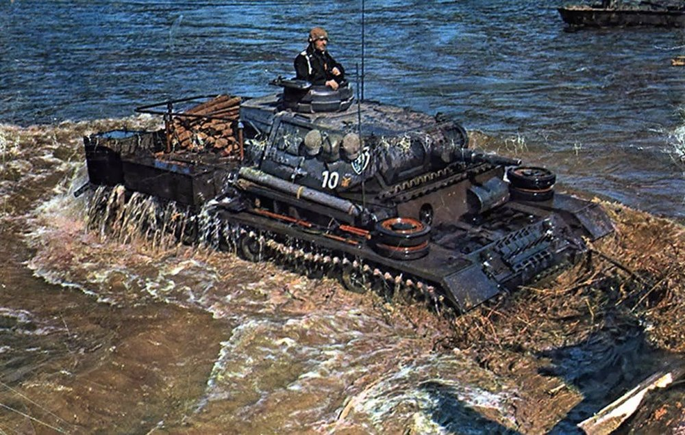 A german world war 2 colour historical image showing Panzer III tank crossing a river.jpg