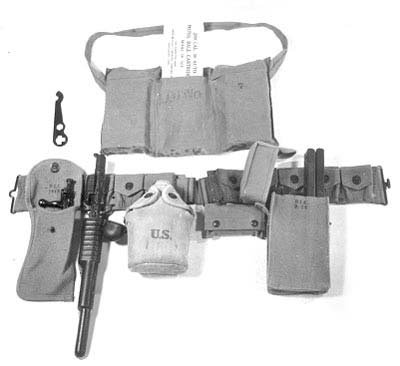 the_standard_infantry_kit_with_the_large_pouches_holding_pedersen_magazines_and_the_metal_case_by_the_canteen_holding_the_device_itself.jpg